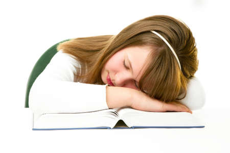 Girl Sleeping with Her Head on an Open Book photo