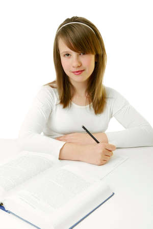 Portrait of Happy young schoolgirl reading book Stock Photo - 2363086