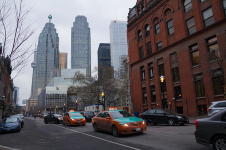 congested: Toronto, Canada - January 27, 2016: Traffic with cabs in downtown Toronto during winter. Toronto is the 4th most congested city in North America