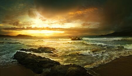 The beautiful landscape of sea elements of fleeing into the sea by fishermen at sunset photo