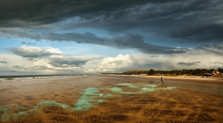 A lone fisherman on the sandy shore unravels network Stock Photo - 16213516