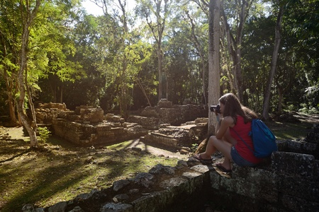 Woman photographing ancient Mayan ruins in Copan in Honduras 2 photo