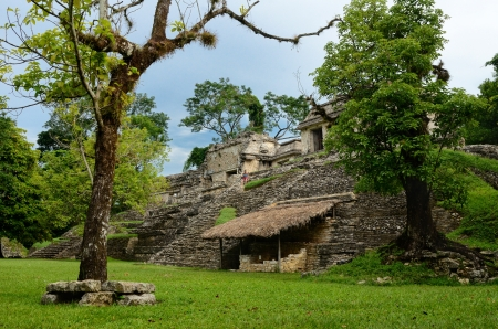 explores: Girl explores archaeological structure in the ancient Mayan city of Palenque, Mexico Stock Photo