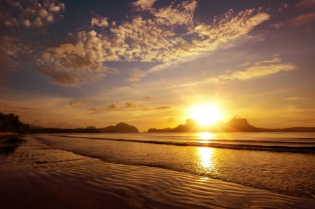 over the sea: Beautiful sunset on the beach amid the islands with the setting sun