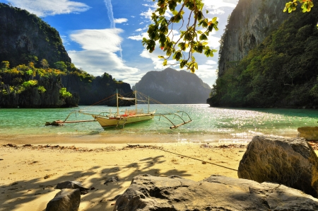 Beautiful beach with rocks on the background of the islands El Nido, Philippines