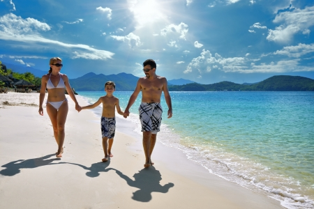 The European family relaxing on the white sandy beach in Asia  Banco de Imagens