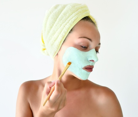 A woman makes a face mask photo