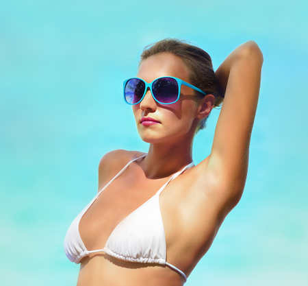beautiful armpit: Fashion portrait of a woman on a background of the sea