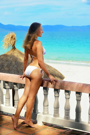 Beautiful woman in bikini on the terrace of dreams  Stok Fotoğraf