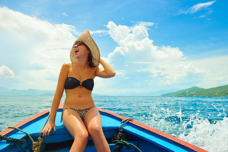 adult vietnam: Happy woman sailing in boat on her summer holidays Stock Photo