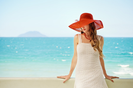 Beautiful elegance model in red hat with red lips  Stock Photo