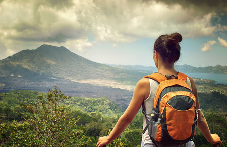 Young traveling woman with backpack. focus on backpack, happy female walking in the island to Bali, discovering world, summer vacation concept Banco de Imagens