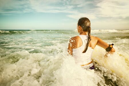 bodyboarding: Surfboard pretty young woman enjoying vacation holiday surfing the ocean.