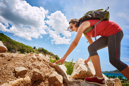 Hiker with backpack walking on a rocky terrain looking at beautiful landscape motivation and inspiration.Traveling along Asia active lifestyle concept