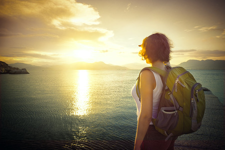 active lifestyle: A young traveller looking at sunset on the islands. Traveling along Asia active lifestyle concept