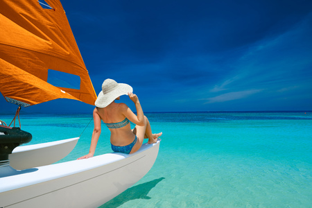 asia: Woman traveling by boat among the islands. Travel to Asia, happiness emotion, summer holiday concept