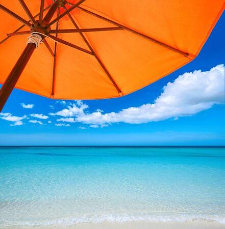 sun umbrella: Red umbrella on  tropical beach. Travel  background. Stock Photo
