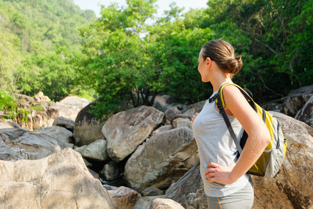 woman alone: girl with backpack traveling  in the mountains. Hiking people concept