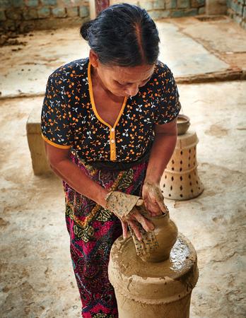 rang: Ninh Thun province, Vietnam - November 2, 2014: A village ceramic Bau Truc, woman creates clay pot traditional handicraft in Vietnam. Using traditional techniques