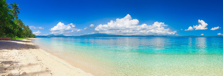 Panoramic view of a tropical beach against the backdrop of the island of Sulawesi. Indonesia Stock Photo