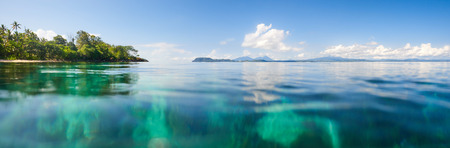 Panoramic view of a beach against the backdrop of the island of Sulawesi. Indonesia