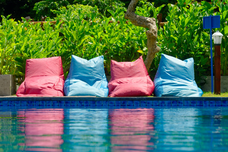 bean bag: many colorful soft seating to relax near the pool in suuny day. Sport and relax concept.