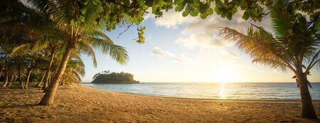 Panorama view on beautiful sunset and tropical beach