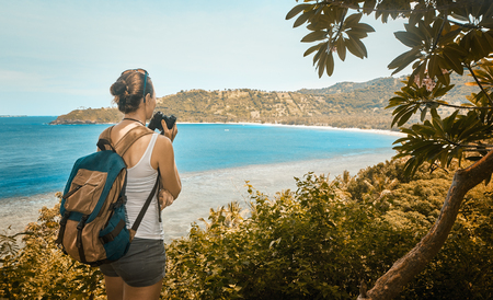 purposeful: Purposeful tourist with backpack enjoying sunny coast view. Traveling along mountains and coast, freedom and active lifestyle concept.