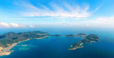 Aerial panoramic view of the sea harbor with cruise ship near the town of Cam Ranh. Vietnam