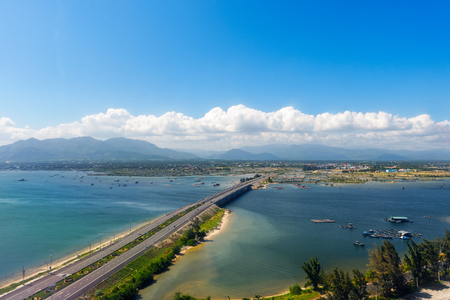 Aerial panoramic view of road and the bridge to the town of Cam Ranh. Vietnam Banque d'images - 105007296