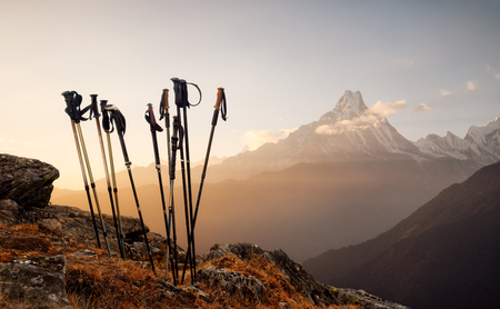 Group of trekking sticks on a mountain top background. Beautiful inspirational landscape, trekking and activity. Stock Photo