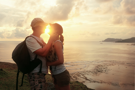 Two hearts full of love. Beautiful young couple embracing and smiling looking into his eyes, standing outdoors. Summer Nature Background. Love Relationship Concept. Banque d'images - 96849515