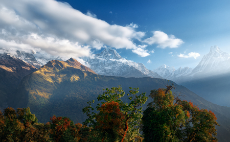 Scenic Himalayas landscape with and mountain ranges on sunrise. Natural mountain background. Peak Machapuchare, Nepal.