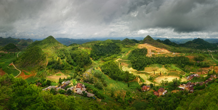 Dramatic beautiful rural landscape with a small village in the North of Vietnam in the Karst Plateau region of Dong Van. Stock Photo