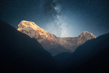 Scenic landscape with a mountain range Annapurna and night sky in stars. Himalaya on early morning. Natural mountain background. Stock Photo