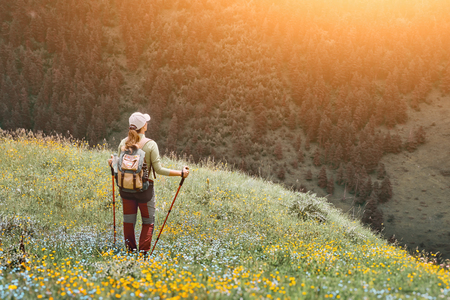 Hiker woman healthy outdoor lifestyle relax and view green forest on mountain 