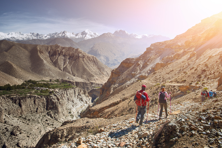 Group hikers walking on a mountain in the Upper Mustang in Nepal.