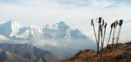 Group of trekking sticks on background mountains range in Himalaya (Upper Mustang). Panoramic view. Beautiful inspirational landscape, trekking and activity.