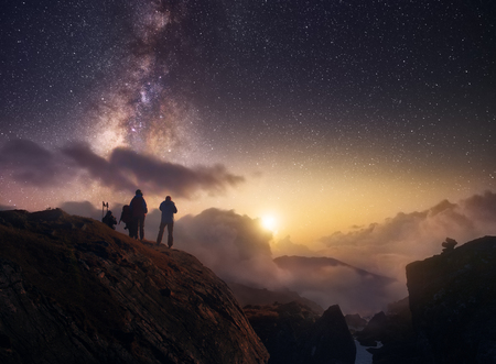 Group of hikers looking at the starry sky in mountains of the Himalayas.