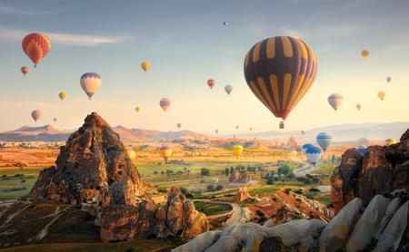 Beautiful morning scenic with a balloon flight over the spectacular Cappadocia, Turkey.