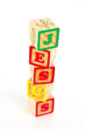 Vintage alphabet blocks spelling out JESUS photo