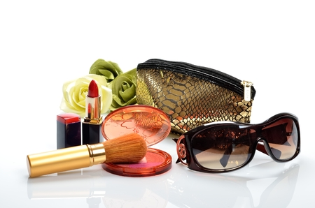 Items for decorative cosmetics, makeup, mirror and flowers photo