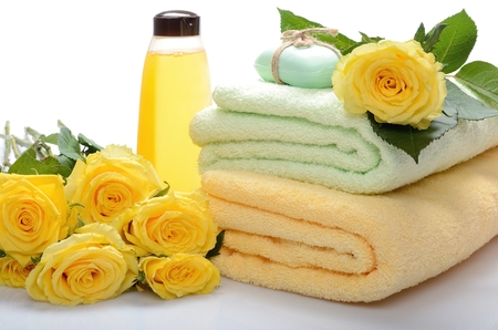 Objects for Spa, sauna, body care - towel, soap, shampoo and flowers still life photo
