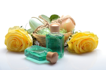 Mini set for spa, sauna bath - small bottles of shampoo, soap and flowers in still life photo