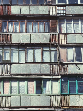 saluzzo: Old building with color bright windows Stock Photo