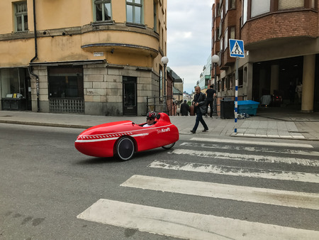 Modern red Velomobile Sport with driver
