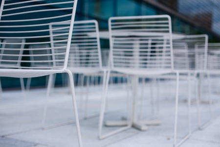 White empty chairs outdoors