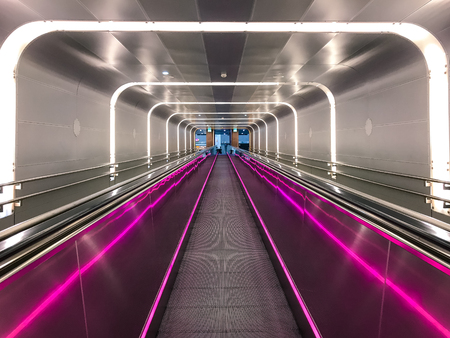 Neon escalator in Train Station Oslo Norway Editorial