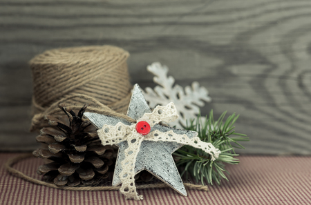 Christmas decoration jute,cones,star on vintage background. photo