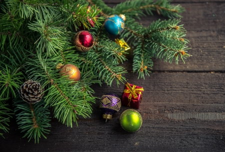 Fir tree with Christmas decoration on wooden background. photo
